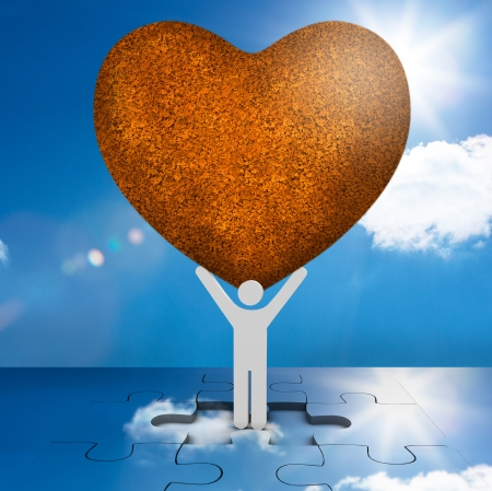 White human representation holding a big brown heart with the sky in background photo
