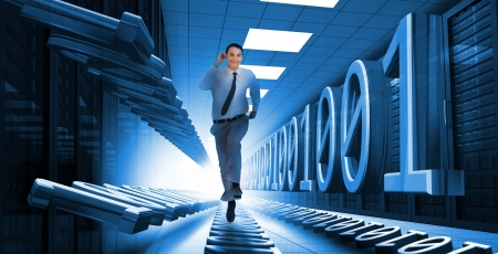 Businessman sprinting through data center with blue binary code photo