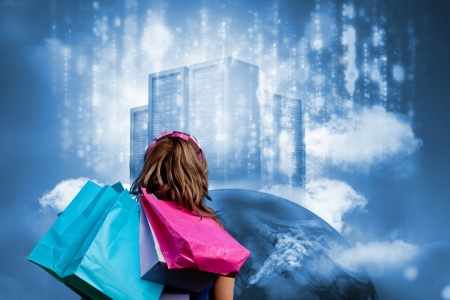 Girl with shopping bags looking at  data server on top of earth with falling matrix photo