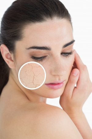 zoomed in: Woman rubbing her skin with close up of her wrinkles on white background