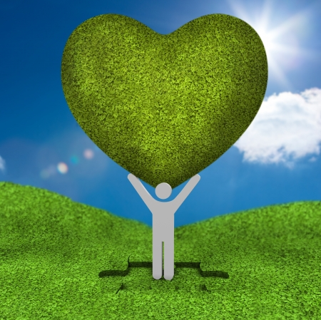 human representation: Human representation holding a big green heart above his head in a meadow