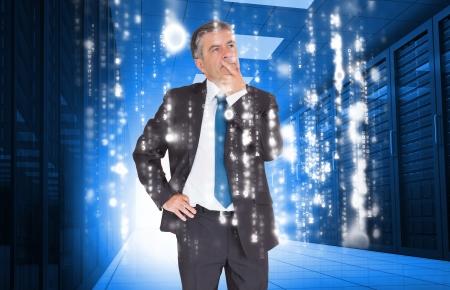 data matrix: Businessman looking thoughtful in data center with raining computer matrix