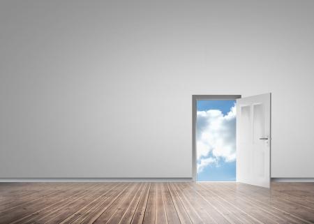 floorboards: Door opening to reveal sunny blue sky in a grey room with floorboards Stock Photo