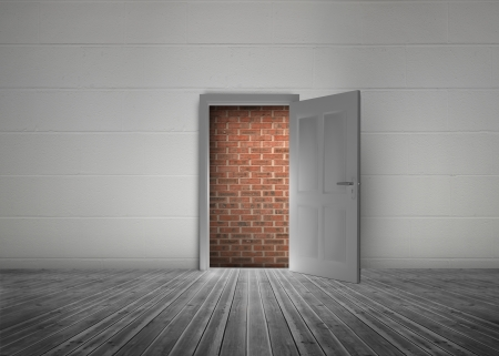 blocking: Door open to reveal red brick wall blocking the way in a dull grey room Stock Photo