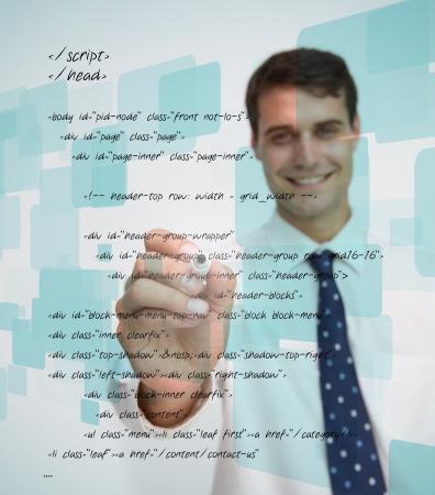sql: Smiling businessman writing sql language on white background