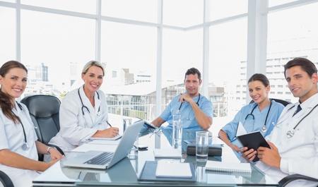 Smiling medical team in a bright meeting room Reklamní fotografie