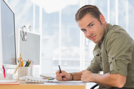 Handsome creative business employee working in a modern office photo