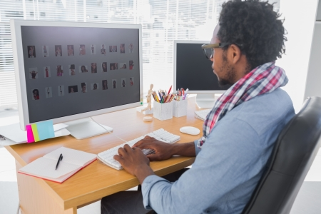 editor: Handsome photo editor working on computer in a modern office
