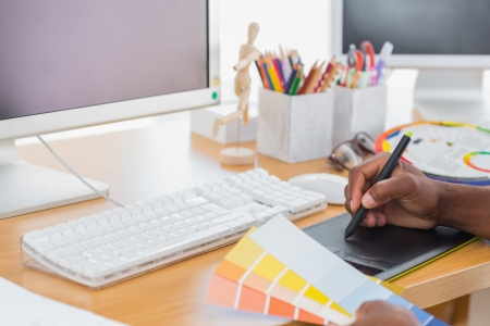 designer working: Designer using a graphics tablet in a modern office