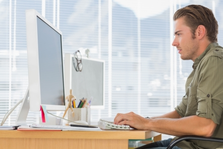 Creative business employee working on computer in a modern office Stock Photo - 20591317
