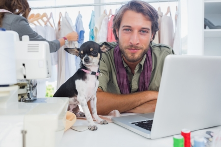 Chihuahua and fashion designer looking at camera photo