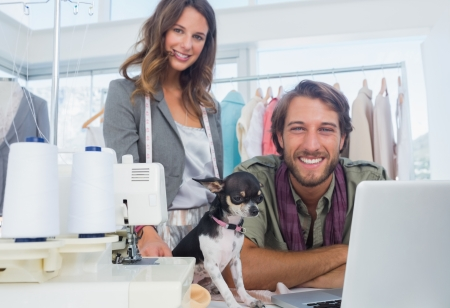Fashion designers and chihuahua looking at camera photo