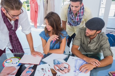 Group of designers working with photos and magazines Stock Photo - 20593570