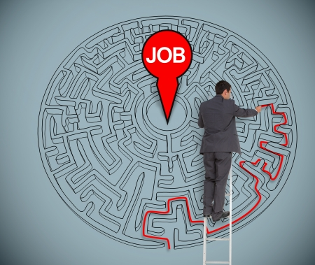work path: Businessman on a ladder trying to find a job in a maze on grey wall