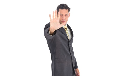 raised hand: Businessman with raised hand on a white background
