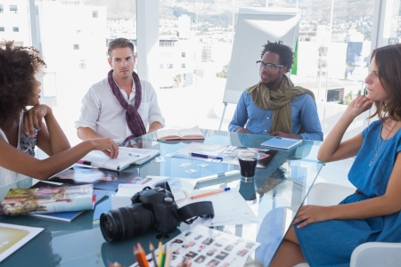 editors: Team of photo editors brainstorming in their bright office Stock Photo