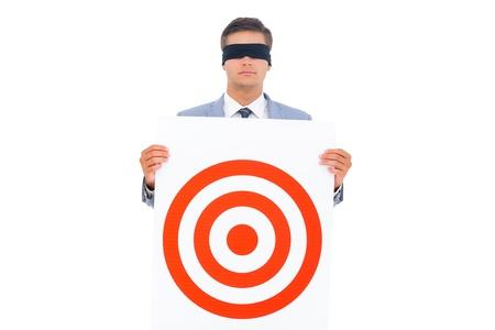 blindfolded: Man with blindfolded holding a target