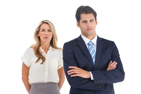 Serious businessman and woman on a white background photo