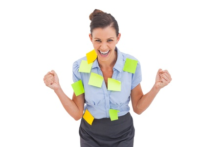 triumphing: Businesswoman triumphing with adhesive notes and looking at the camera Stock Photo