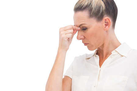 Businesswoman pinching nose because of headache photo