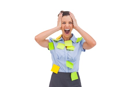 Overworked businesswoman screaming with hand on head photo