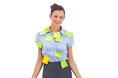 Smiling businesswoman with sticky notes photo