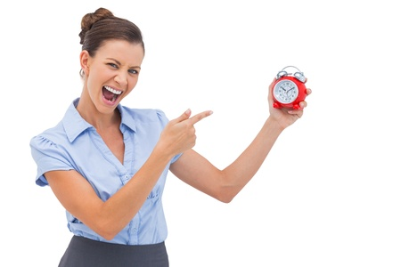 Businesswoman indicating alarm clock with finger photo