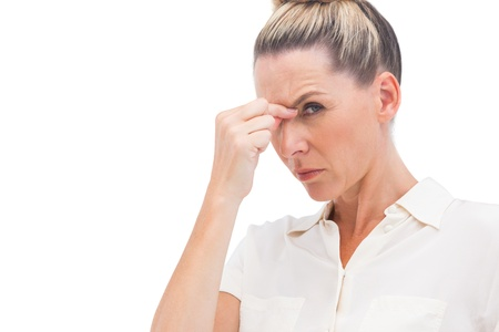 Businesswoman having headache on a white background photo