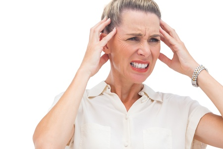 wincing: Businesswoman with painful headache and hand on head