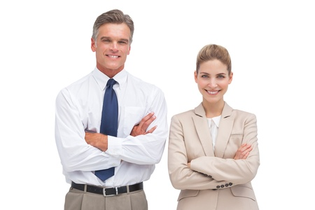 Mature businessman standing with his coworker looking at the camera photo