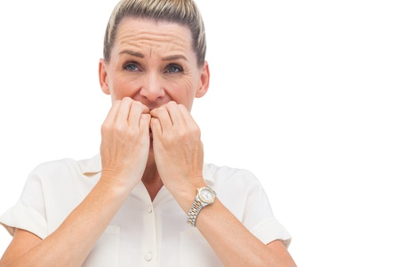 wincing: Anxious businessman biting nails and looking away Stock Photo