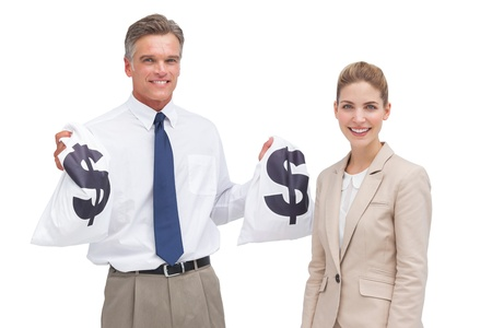 Smiling mature businessman and coworker showing money bags to the camera photo