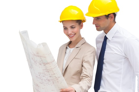 well read: Architect team looking at construction plan with yellow helmets Stock Photo