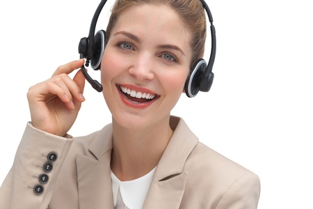 Laughing operator talking on headset looking at the camera photo