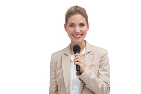 Smiling businesswoman with microphone on white background photo