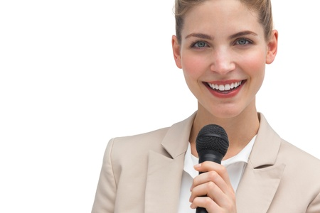 Classy businesswoman holding microphone on white background photo