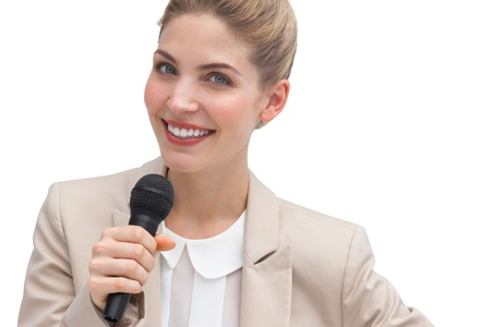 Businesswoman public speaking with microphone photo