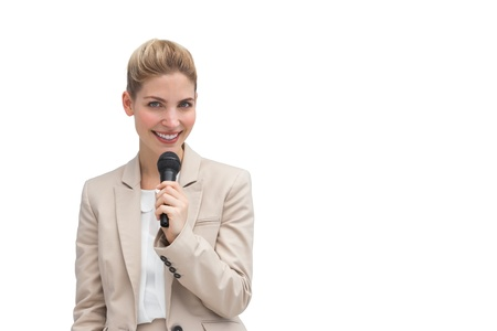 Stylish businesswoman holding microphone on white background photo