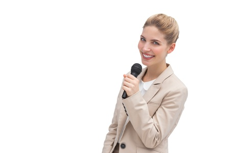 A well dressed woman with microphone on her hand photo
