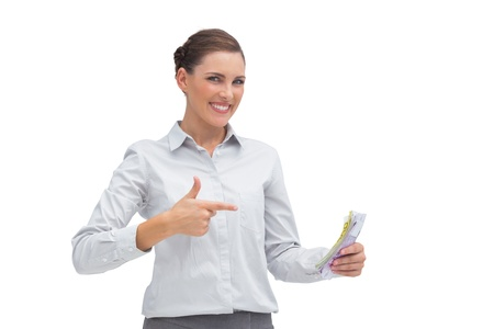 Happy businesswoman with money in her hand on white background Stock Photo - 20539174
