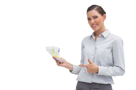 Happy businesswoman showing money in her hand on white background Stock Photo - 20539227