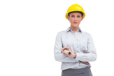 Architect woman with yellow helmet and rolled up plan on white background photo