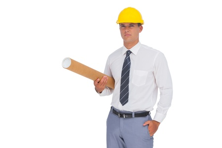 Architect holding a rolled up plan on white background photo