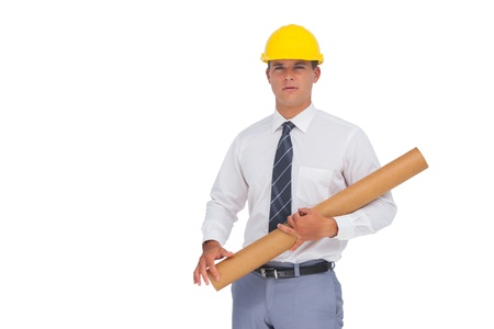 Architect holding a rolled up blueprint on white background photo