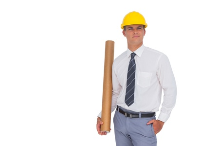 Happy architect holding a rolled up blueprint on white background photo