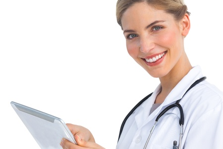 Smiling nurse with tablet pc looking at the camera photo