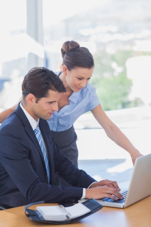 Business people working together with a laptop in the office Stock Photo - 20591342