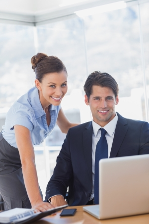Business people smiling in the office Stock Photo - 20591257