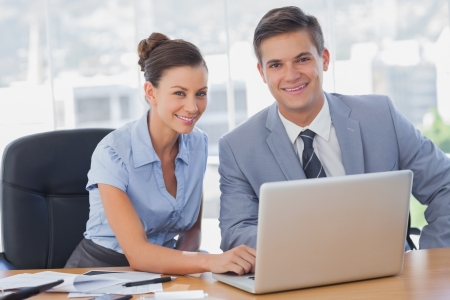 Smiling business people working together in the office Stock Photo - 20591570