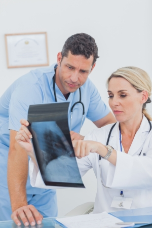 Team of doctors checking an x-ray in a medical office photo
